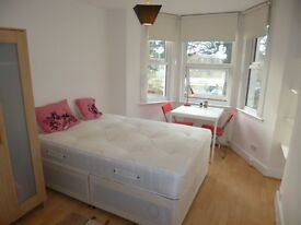 lovely large bright and sunny fully self contained studio flat available now