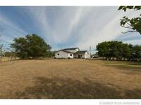 BEAUTIFUL HOME ON JUST OVER 2 ACRES JUST OUTSIDE OF MEDICINE HAT