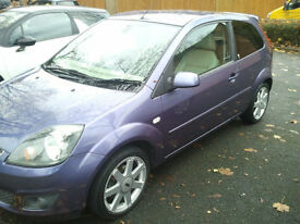 Ford Fiesta ghia limited edition with full cream leather interior and low mileage.