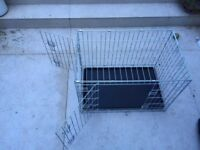 Dog cage with two openings and ground base. Medium size