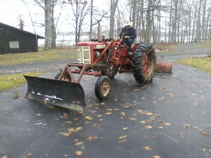 FARMALL 230 with plows