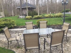 Almost new patio table and 6 chairs
