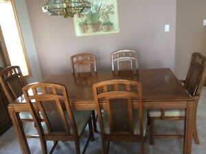 Solid wood dining room table, chairs & cabinet