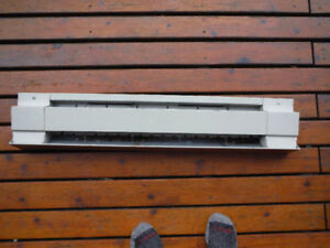 "36"" inch baseboard heater. 220v 750 watt still 100% efficient."