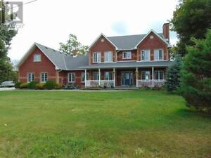 Executive all brick waterfront 3410 sf home on Lake Huron