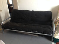Sofa Bed, black fabric with metal base. Used but comfortable. Easy to transform into bed.