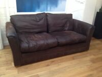 Quality large dark brown leather 2-seater sofa