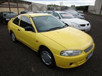 2003 Mitsubishi Lancer CE GLI Yellow 5 Speed Manual Coupe Laverton Wyndham Area Preview