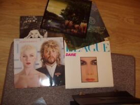 22 Vinyl LP's in carry box - will sell separately