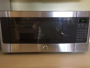 2 available GE Spacemaker Microwave Ovens