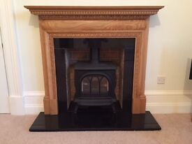 Beautiful and nearly new Mantle, Gas Stove, brick effect Back board and Granite Hearth for Sale.