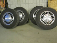 4 Michelin Defender tires mounted on 1995 Cadillac rims