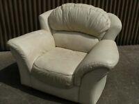 Cream leather armchair.