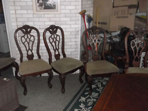 Solid Wood Table Two Leaves 4 chairs great for  a big Family