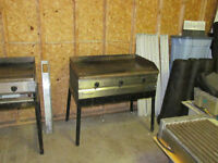 "Two MKE 36"" Propane flat grills with stands"