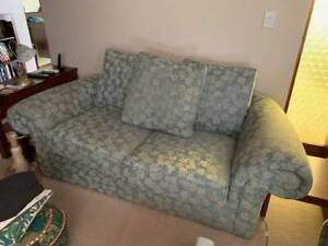 Two older style two seater lounges leaf pattern good condition free