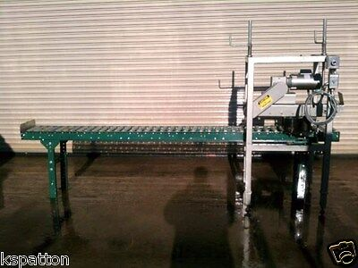 Case Conveyor With Powered Top Case Compression Unit And Roll On Date Coder