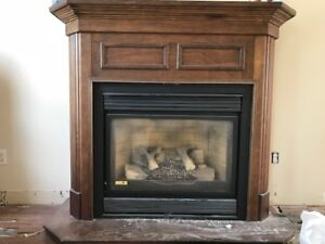 CONTINENTAL GAS FIREPLACE (NATURAL GAS) & WOOD MANTEL