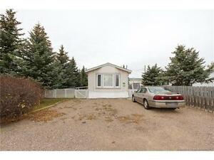 WELL CARED FOR MODULAR HOME ON LARGE LOT !