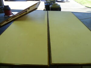 3 Wooden trestle tables with metal folding legs for sale.