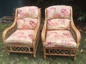 2 CANE RATTAN WICKER CONSERVATORY CHAIRS WITH FOOTSTOOL AND CUSHIONS