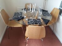 GLASS ROUND DINING TABLE AND 4 X CHAIRS . GOOD CONDITION PINE CHAIRS AND TABLE LEGS
