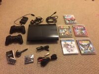 Playstation 3 (PS3) 250gb Super Slim with 5 Games, 2 Controllers and Accessories