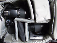 canon EOS 1100D + various folters, Telephoto lens battery charger , spare battery