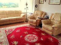 Three-piece buttermilk leather lounge suite