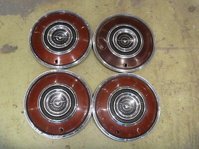 VINTAGE SET OF 4 EARLY FORD THUNDERBIRD HUBCAPS