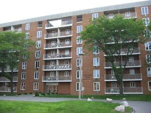 Will trade townhouse w/gas heating central air for 1 bdm condo
