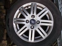 A set of 4 2004 Ford focus Alloy wheels & tyres 195 60 R15 & wheel nuts