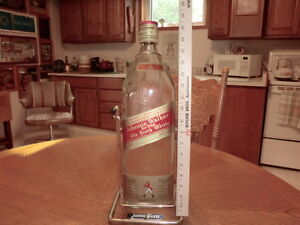 Johny Walker Red Lable Scotch bottle and cradle $10.00.