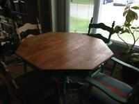Six-sided dining room table and 6 chairs