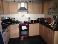 Fitted Kitchen (Beech Wood) with integrated appliances including fridge/freezer and dishwasher