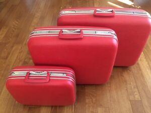 Beautiful 60's Red Jetliner 3 piece luggage set