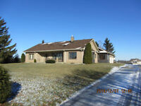 Nice bungalow on 6+ acres in the heart of Manotick