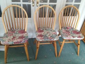 6 ladder back chairs complete with cushions covers.