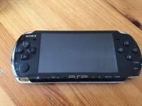 PSP 3000 + 4 Games