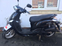 Only 12 months old, automatic 115cc scooter in black. One female owner. Only £2.50 to fill up!