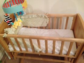 Mothercare deluxe gliding crib with additional mattress