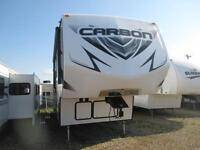 Pre Owned 2015 Carbon 297 Toy Hauler Fifth Wheel