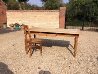 Rustic pine kitchen table with five chairs