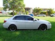 2010 Subaru Impreza MY11 R (AWD) White 5 Speed Manual Sedan Chermside Brisbane North East Preview