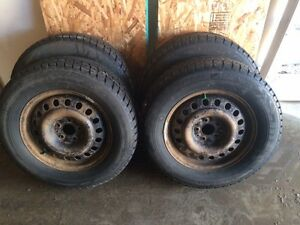 BLIZZAK WINTER TIRES 235/65R17 WITH STEEL RIMS QTY4