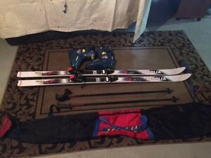 Tyrolia Skis, boots, poles, bag  Package Deal
