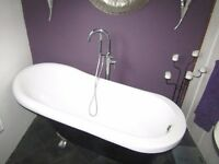 Roll top bath with ball and claw feet and free standing tap/shower