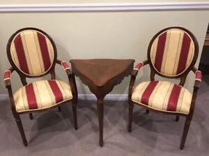 2 beautiful accent chairs and triangular table
