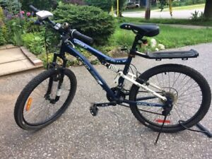 """24"""" 21-speed CCM Mountain bicycle (with light and U-lock)"""
