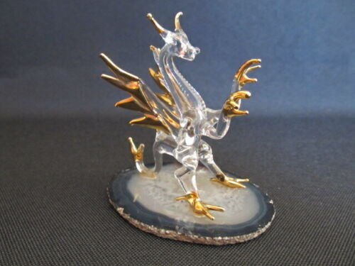 Crystal Glass Asian Dragon Figurine with gold accents on display stone base